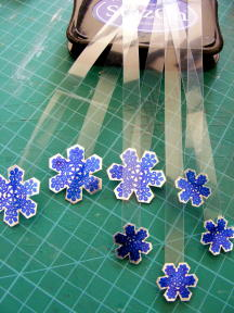 13 ATACH SNOW FLAKES TO ACETATE